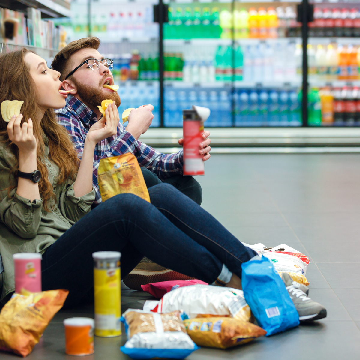 Couple eating junk food