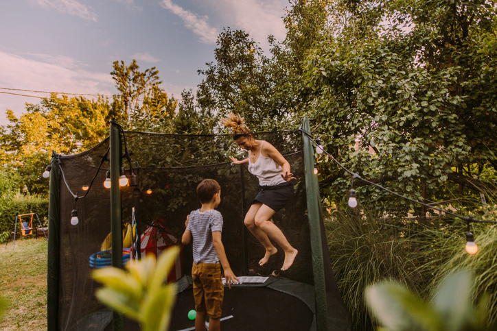 mom and son jumping and getting the benefits of rebounding trampolining