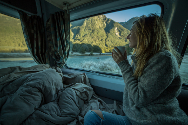 woman drinking yerba mate from her camper in the morning